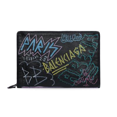 graffiti detail clutch bag